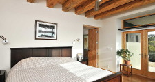 13RM Stone and Steel House master bedroom 1